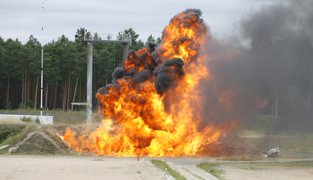 An 11 kg propane cylinder is underfired which results in the failure of the container and a fireball.