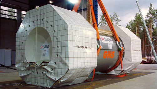 A container for highly radioactive waste is prepared for a drop test at the drop test facility.