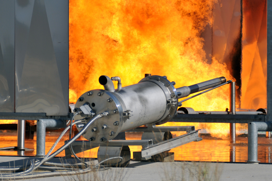 Investigations of ignition and subsequent fire as a result of a gas release from a fuel tank