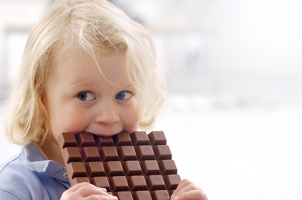Child with a chocolate bar