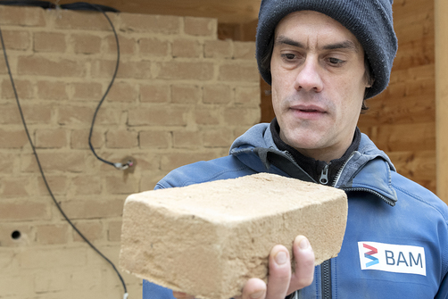 Philipp Wiehle with an earth brick