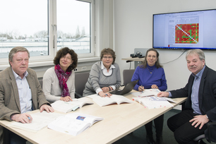 A team of BAM and PTB sitting on a table and investigate how a globally consistent assessment and classification of hazardous chemicals could be achieved